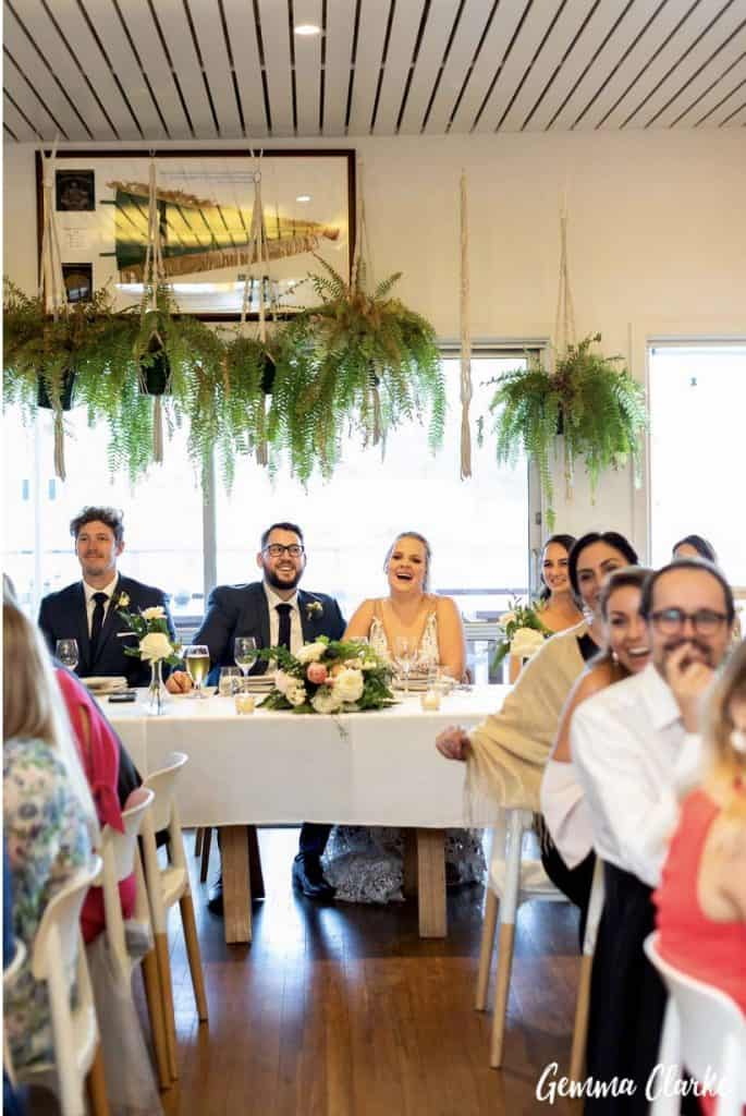 sydney-wedding-reception-packages-flying-squadron-kirribillii-greenery-hanging-bridal-table