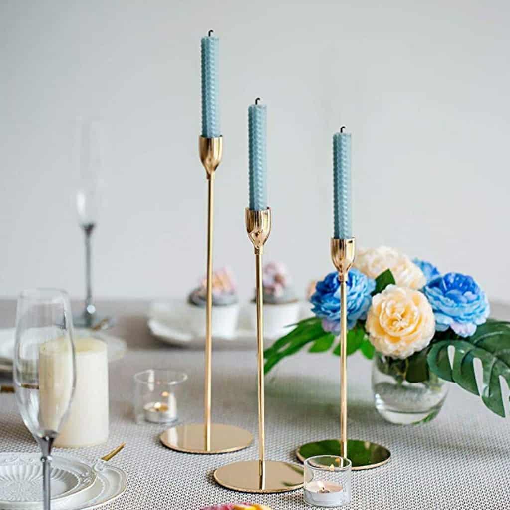 Gold taper candle sticks, 3 sizes per set